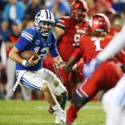 Brigham Young Cougars quarterback Tanner Mangum (12) scrambles in Provo on Saturday, Sept. 9, 2017.