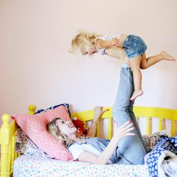 Brooke White is photographed with her daughter, London.