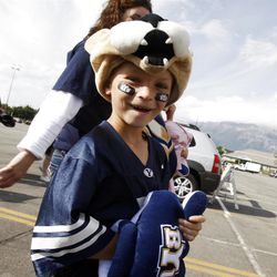 BYU fan Kanyon Petersen ,CQ, walks towards the stadium as BYU and Utah get set to play Saturday, Sept. 17, 2011 at Lavell Edwards Stadium.