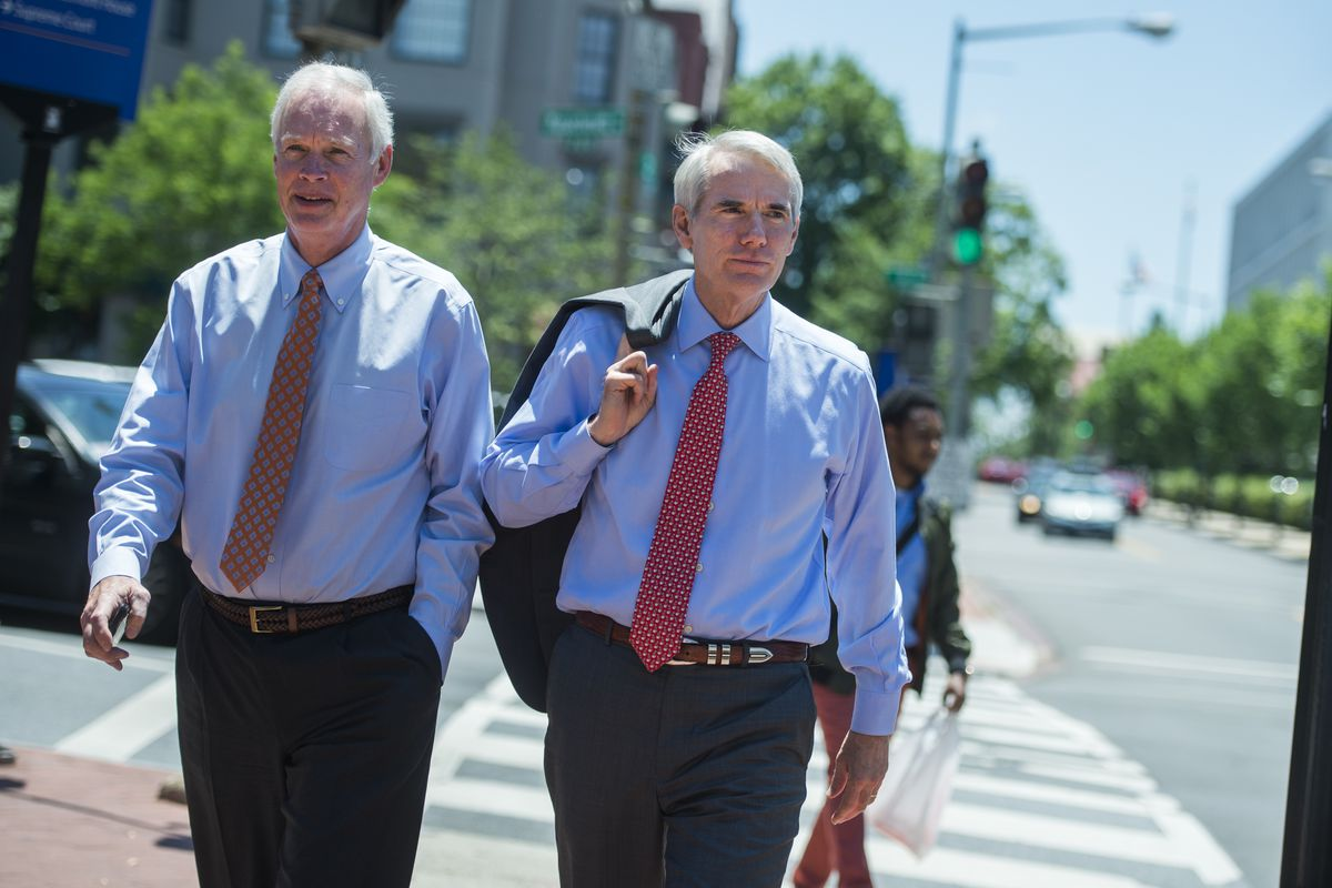 Portman and Johnson on the street without suit jackets.