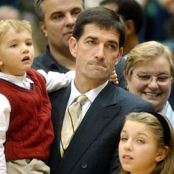 John Stockton holds his son during the retiring of his Jersey at halftime against the Hornets in Salt Lake City Utah.