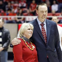 Jodi Majerus, a sister of the late Coach Rick Majerus, and former player Keith Van Horn hug during a halftime tribute at the University of Utah's Huntsman Center in Salt Lake City on Saturday, Feb.2, 2013. Coach Majerus, who passed away Dec. 1, coached the Utes from 1989-2004 — posting a 323-95 record and an appearance in the 1998 NCAA championship game.
