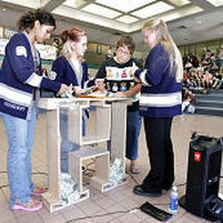 Hunter Hgh students Fusi Tuineau, Sable Davis. Brianna Prado and Kathy Pierce place money collected from Hunter High students to help the family
