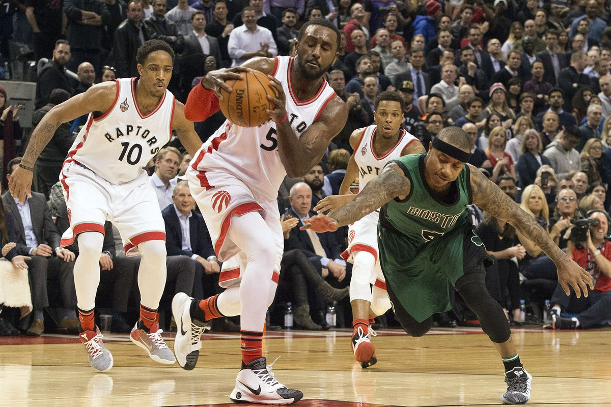 Patrick Patterson secures the ball as Isaiah Thomas tries for the steal.