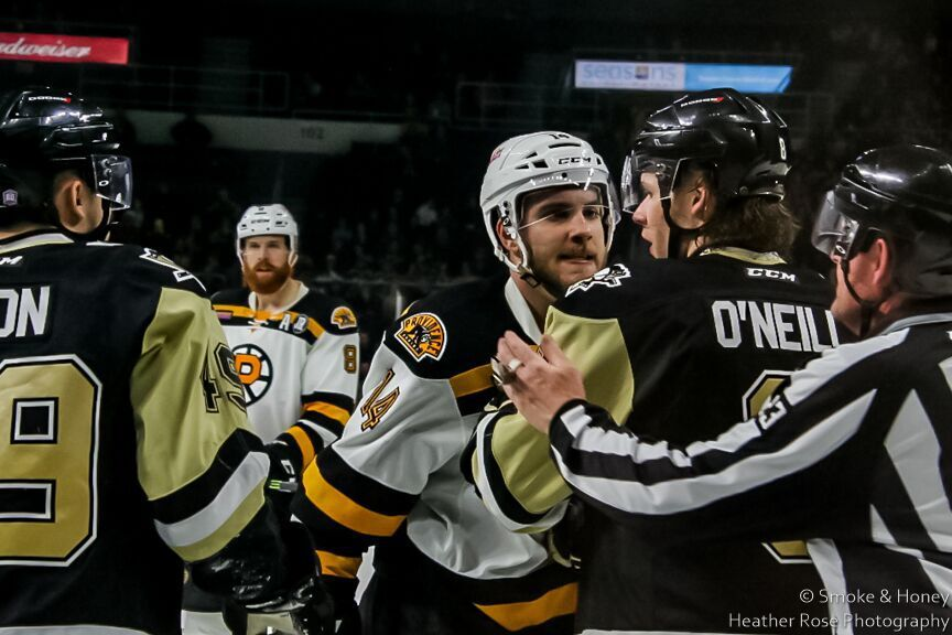 Providence forward Ben Sexton (14) stares into the soul of WB/Scranton defender Will O'Neill's (8) soul during play last night at the Dunkin Donuts Center.