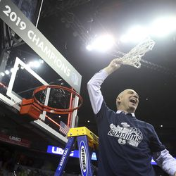 Utah State's coach Craig Smith swings the net after defeating San Diego State in Mountain West Conference championship game Saturday, March 16, 2019, in Las Vegas. Smith was named head coach of the Runnin' Utes on March 27, 2021, replacing Larry Krystkowiak.