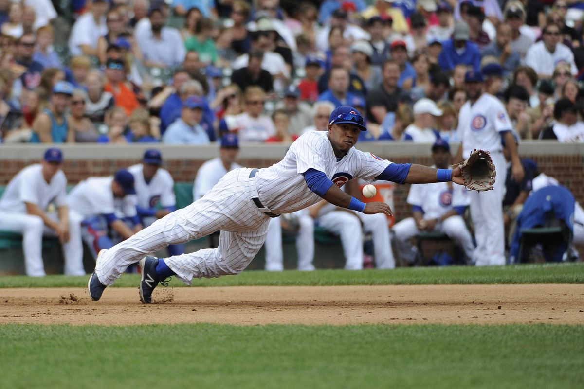 Luis Valbuena of the Chicago Cubs makes a diving catch against the San Francisco Giants at Wrigley Field in Chicago, Illinois. (Photo by David Banks/Getty Images)