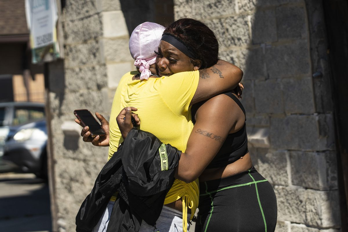 A woman — identifying herself as a family member of one of the women who was killed — receives a hug from a supporter outside the crime scene tape at West 63rd Street and South Morgan Street, Tuesday morning, June 15, 2021. Four people were shot and killed inside a home in the 6200 block of South Morgan, in an incident that left four others wounded.