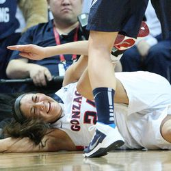 Gonzaga Bulldogs guard Keani Albanez (24) hits the floor hard during the West Coast Conference championship game in Las Vegas Tuesday, March 11, 2014. BYU lost 71-57.