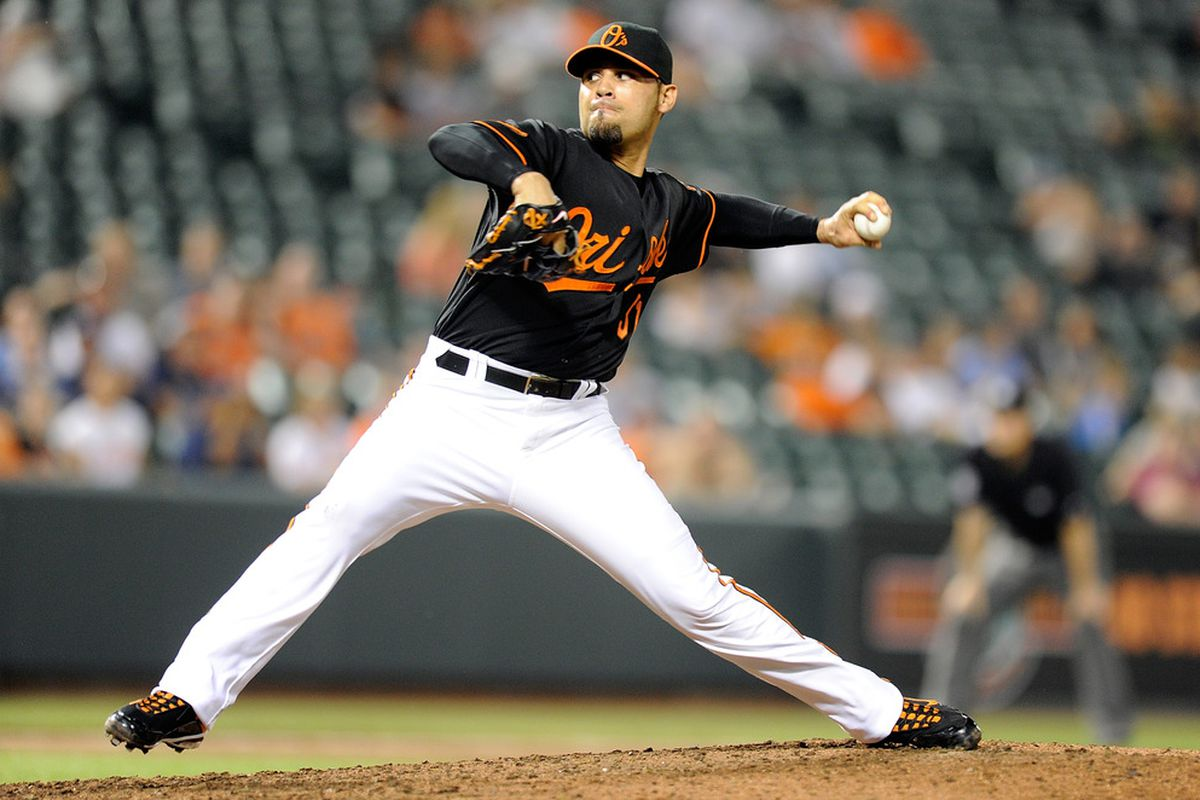 BALTIMORE, MD - JUNE 10:  Mike Gonzalez #51 of the Baltimore Orioles pitches against the Tampa Bay Rays at Oriole Park at Camden Yards on June 10, 2011 in Baltimore, Maryland. The Orioles won the game 7-0. (Photo by Greg Fiume/Getty Images)