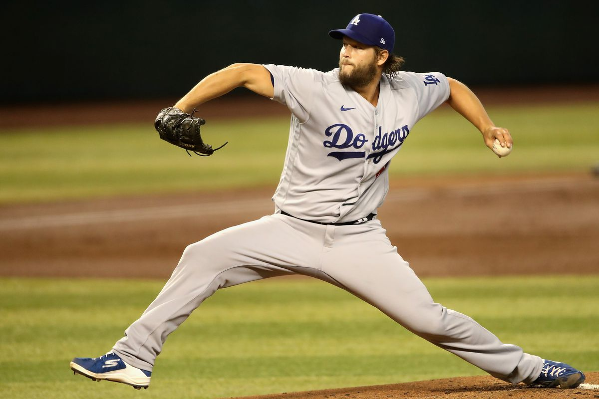 Starting pitcher Clayton Kershaw #22 of the Los Angeles Dodgers throws a pitch against the Arizona Diamondbacks during the first inning of the MLB game at Chase Field on August 02, 2020 in Phoenix, Arizona.