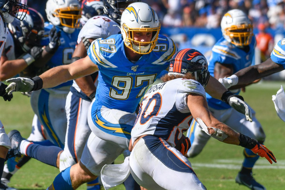 Los Angeles Chargers defensive end Joey Bosa tries to chase downDenver Broncos running back Phillip Lindsay during a 4th quarter running play at Dignity Health Sports Park.