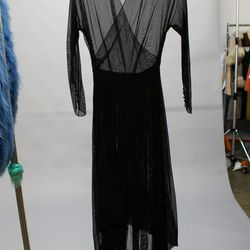 We wanted to take this sheer black piece home the minute we laid eyes on it.