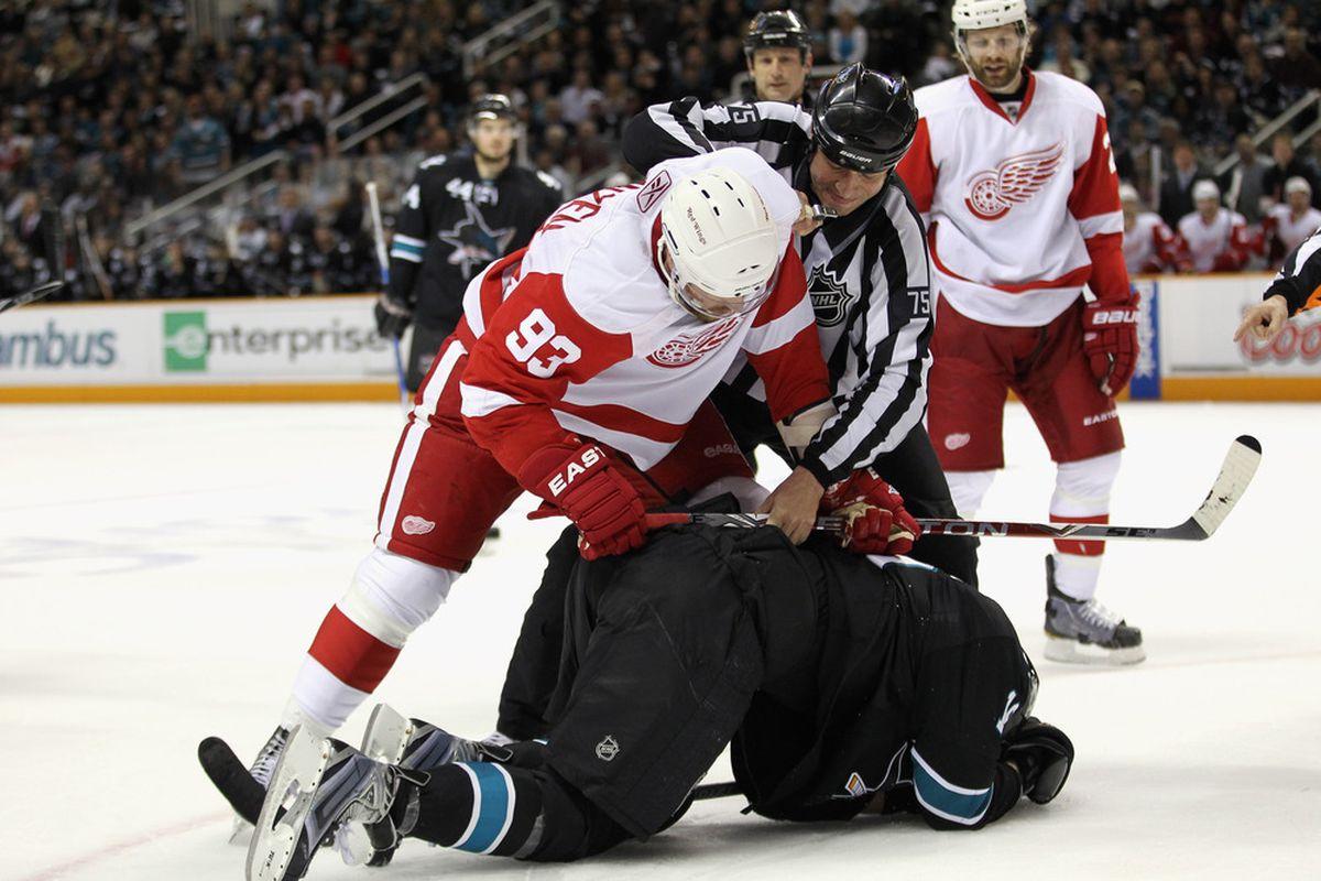 Joe Thornton surrenders. (Photo by Ezra Shaw/Getty Images)