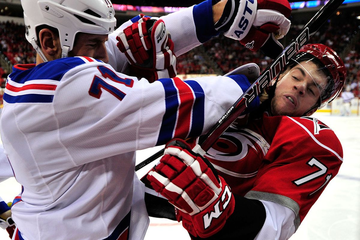 RALEIGH, NC - MARCH 01:  Mike Rupp #71 of the New York Rangers checks Jerome Samson #71 of the Carolina Hurricanes during play at the RBC Center on March 1, 2012 in Raleigh, North Carolina.  (Photo by Grant Halverson/Getty Images)