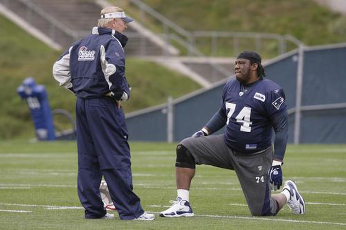 <em>New Patriot DL Terdell Sands at practice yesterday.  At 6'7, 335 lbs, this very large man has to kneel just to fit in this photo.</em>