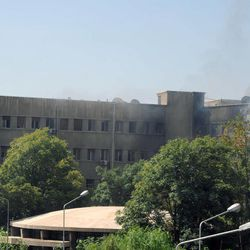 This photo released by the Syrian official news agency SANA, shows smoke rising from Syria's army command headquarters in Damascus, Syria,Wednesday, Sept. 26, 2012. Twin blasts targeting Syria's army command headquarters rocked the capital on Wednesday, setting off hours of sporadic gunbattles and a raging fire inside the heavily guarded compound, state-run media and witnesses said.