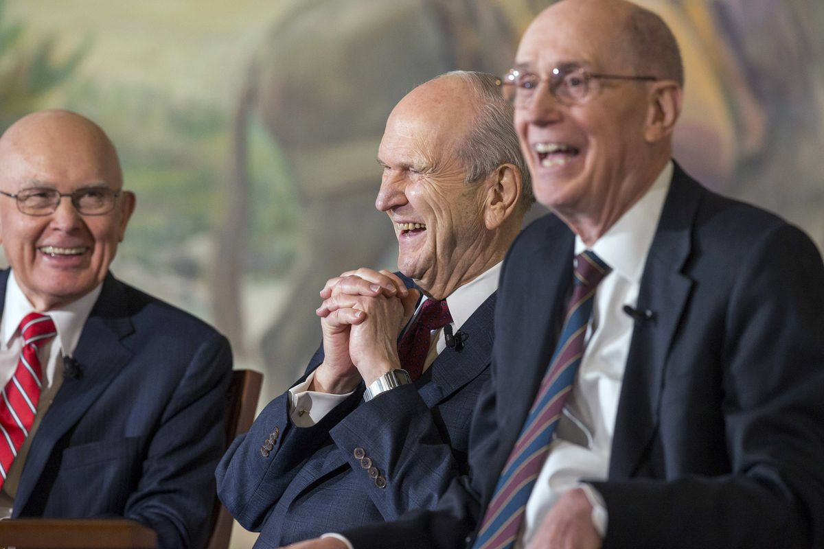 President Russell M. Nelson, the 17th president of The Church of Jesus Christ of Latter-day Saints, and his counselors — President Dallin H. Oaks, first counselor (left), and President Henry B. Eyring, second counselor (right) — share in a laugh at a pres