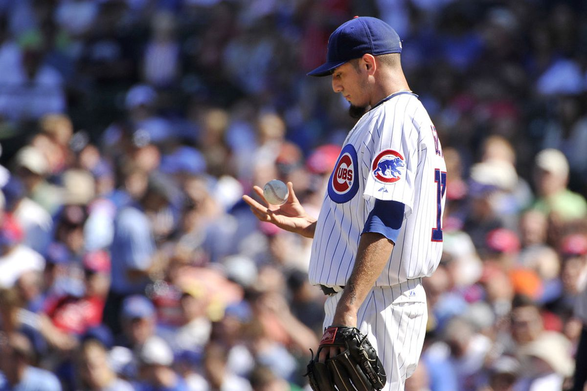 Starting pitcher Matt Garza of the Chicago Cubs flips a ball during the third inning against the Atlanta Braves at Wrigley Field in Chicago, Illinois. The Braves defeated the Cubs 8-3.  (Photo by Brian Kersey/Getty Images)