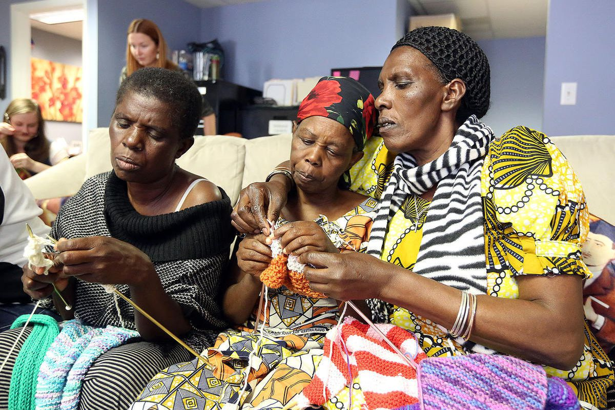 _FILE - Mifunga Lyonze, Sifora Bamurange and Christine Mukankusi knit at a knitting group meeting for refugee women at the Utah Health and Human Rights office in Salt Lake City, on Tuesday, Oct. 3, 2017._
