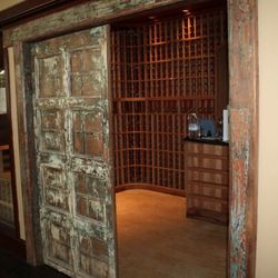 Inside the expansive walk-in wine storage room.