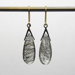 """Sticks and Stones Earrings with Tourmilated Quartz, <a href=""""http://www.hannahblount.com/collections/sticks-and-stones/products/sticks-and-stones-earrings-with-tourmilated-quartz#"""">$146</a>"""