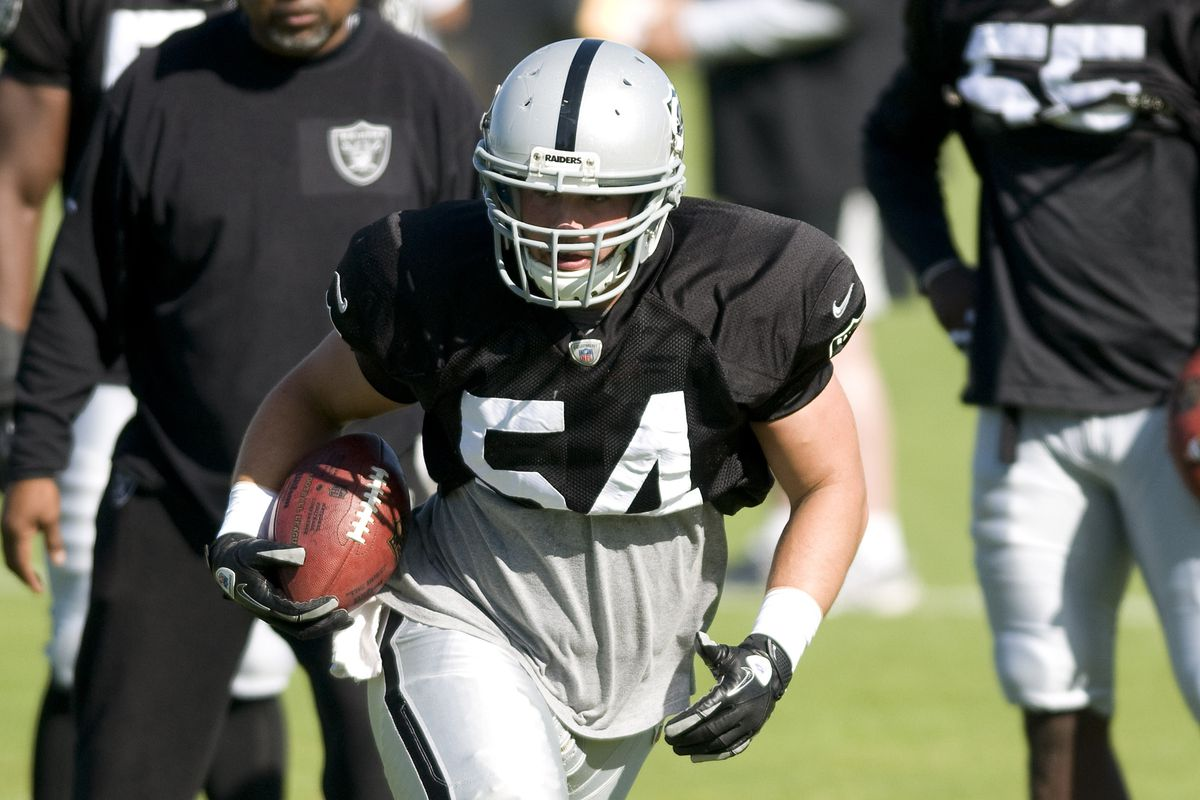 Oakland Raiders linebacker Nathan Stupar (54) carries the ball during training camp