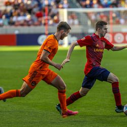 Real Salt Lake defender AAndrew Brody (2) battles Houston Dynamo defender Adam Lundkvist (3) for the ball as RSL and Houston play an MLS soccer game at Rio Tinto Stadium in Sandy on Saturday, June 26, 2021.