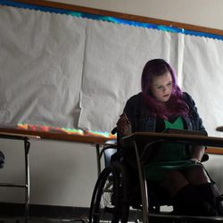 Stacy Davis-Stanford attends class at Salt Lake Community College in Salt Lake City on Thursday, Feb. 27, 2014. Davis-Stanford is in a wheelchair from a debilitating car accident, which caused her to lose her job and thus, her insurance options. She also has other conditions (lupus, kidney disease, neurological issues). She's racked up $200,000 in medical bills and can't afford to get the tests or surgery she needs.