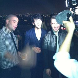 A super blurry shot of Glee's Mark Salling with Joe and Kevin Jonas. Even other celebs wanted to take pics with them!