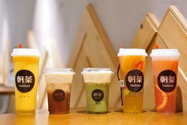 Five cups of milk tea on a table.