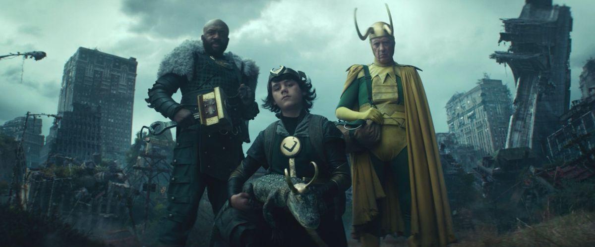 Mjolner Loki, Kid Loki, Alligator Loki, and Old Loki stand in front of a crumbling New York