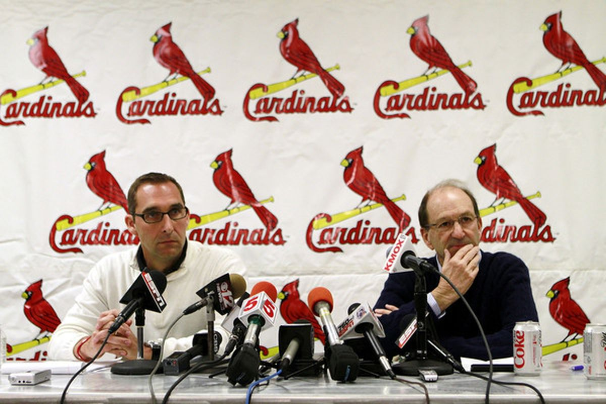 JUPITER FL - FEBRUARY 16:  General Manager John Mozeliak (L) and owner William DeWitt Jr. of the St. Louis Cardinals speak at a press conference at Roger Dean Stadium on February 16 2011 in Jupiter Florida.  (Photo by Marc Serota/Getty Images)