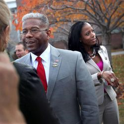 Former Congressman and retired Army Lt. Col. Allen West greets fans with congressional hopeful Mia Love before a town hall luncheon in Sandy on Wednesday, Nov. 13, 2013.