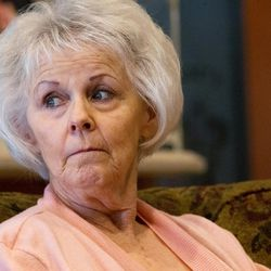 Linda Garfield, of Mona, looks at her husband, Rex, as they talk about how they were defrauded of their retirement savings by investment adviser Tom Andrews on Tuesday, Sept. 13, 2016.
