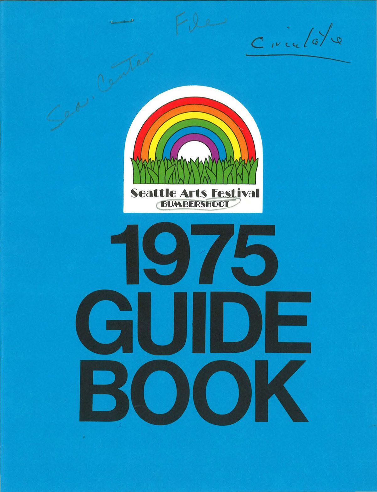 """A blue page has a logo with rainbow over grass that reads """"Seattle Arts Festival BUMBERSHOOT"""" at the top, and """"1975 GUIDE BOOK"""" in large text below."""