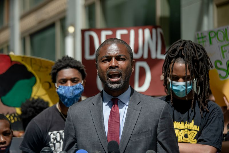 State Rep. La Shawn Ford joins a protest in June.
