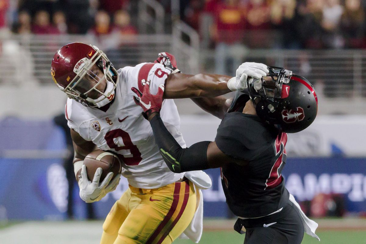 Smith-Schuster stiff-arms a Stanford defender (GettyImages)