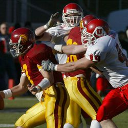 USC quarterback Carson Palmer is chased by Utah's CR Dwinell as  Utah beat USC 10-7 in the Las Vegas Bowl on Dec. 25, 2001. Photo by Tom Smart