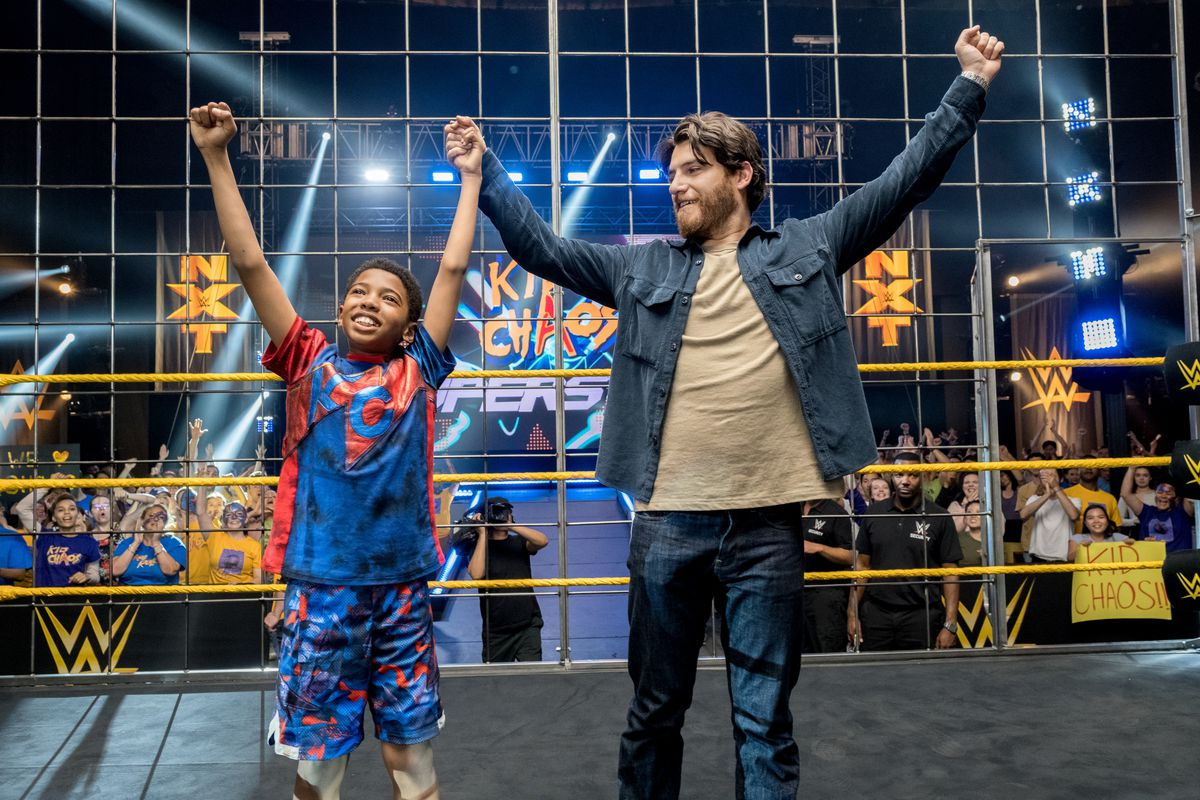 leo raises his hands triumphantly in the ring with his father in The Main Event
