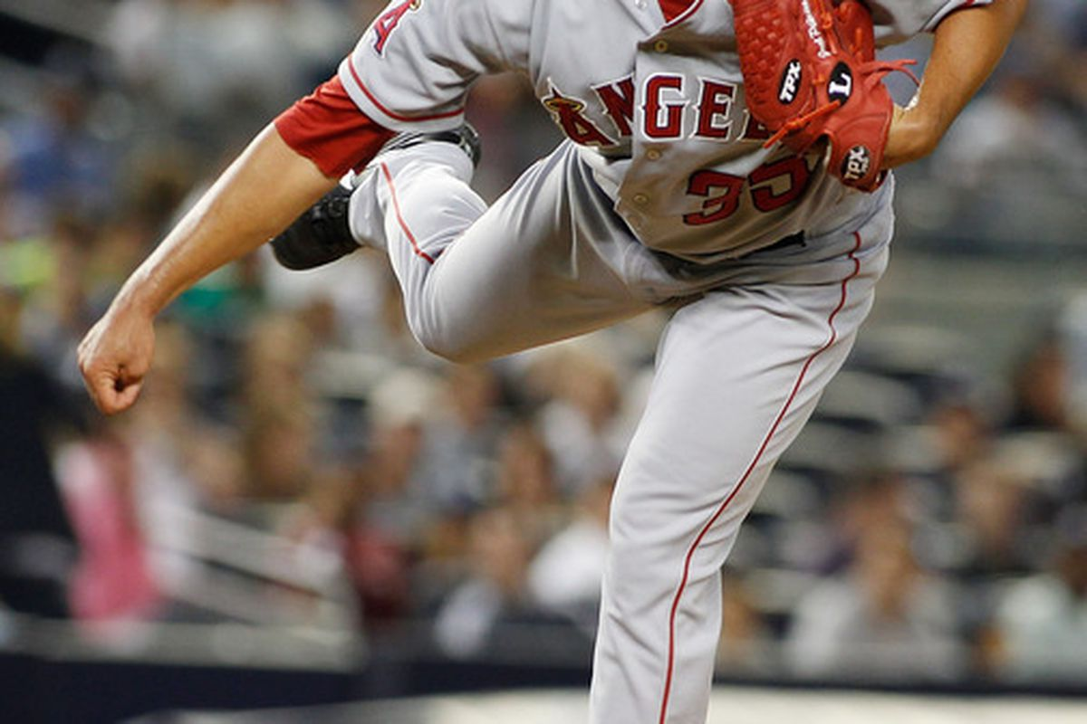 NEW YORK, NY - AUGUST 10:  Joel Pineiro #35 of the Los Angeles Angels of Anaheim delivers a pitch against the New York Yankees on August 10, 2011 at Yankee Stadium in the Bronx borough of New York City.  (Photo by Mike Stobe/Getty Images)