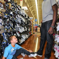 Orlando Magic forward Andrew Nicholson takes youth from the Boys and Girls Club shopping as part of the Magic and Pepsi holiday shopping spree on December 18