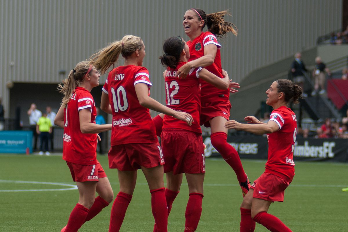 The Thorns celebrate Vero's 54th minute goal during their 1-0 victory over the Houston Dash on August 3, 2014.