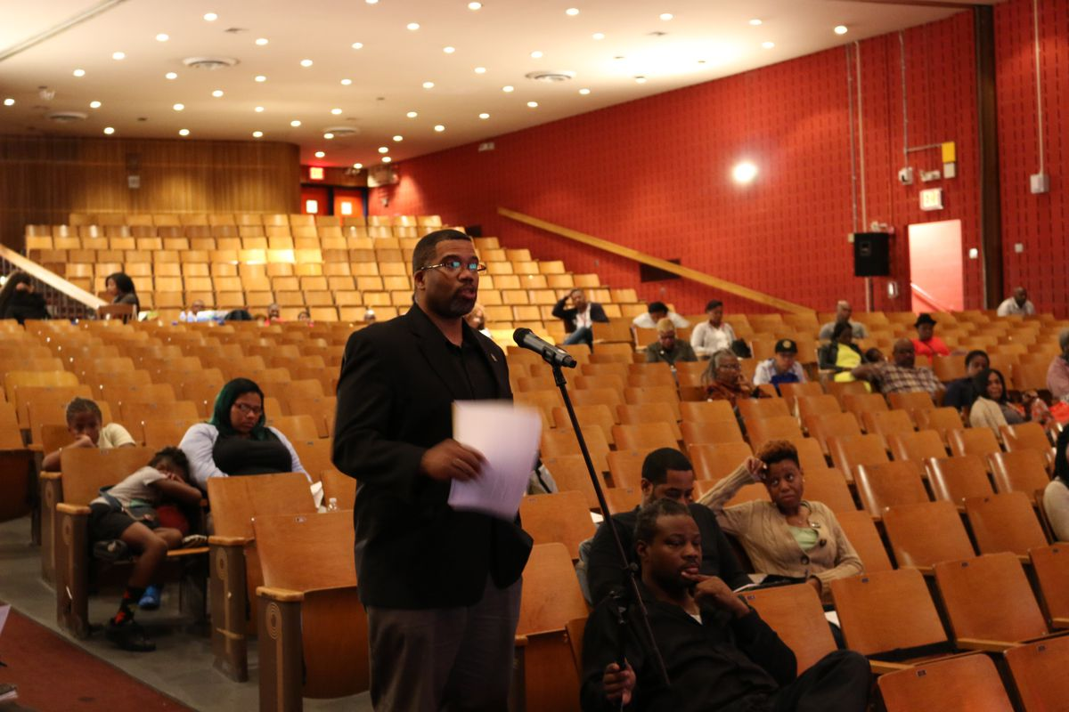 A community member speaks at public hearing at Brooklyn's Boys and Girls High School.