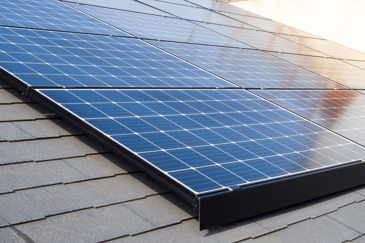 A close up shot of solar panels on a roof.