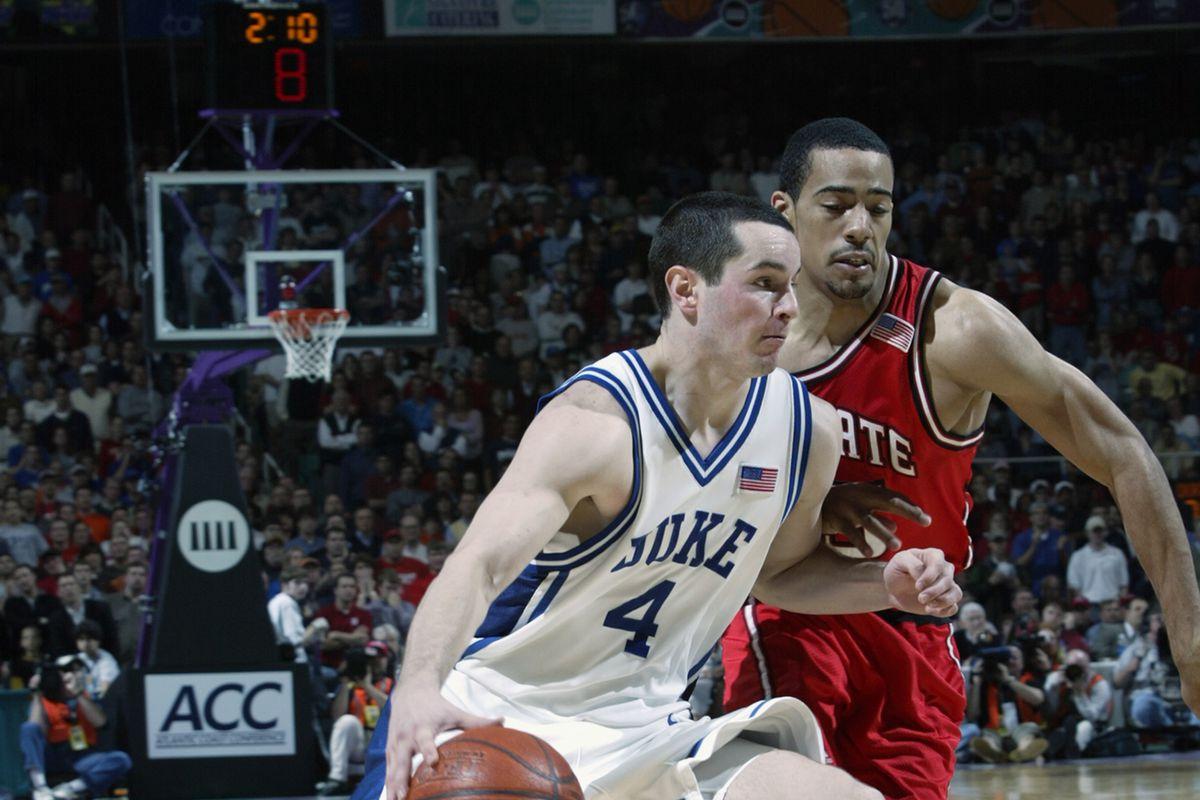 J.J. Redick #4 of Duke drives to the basket