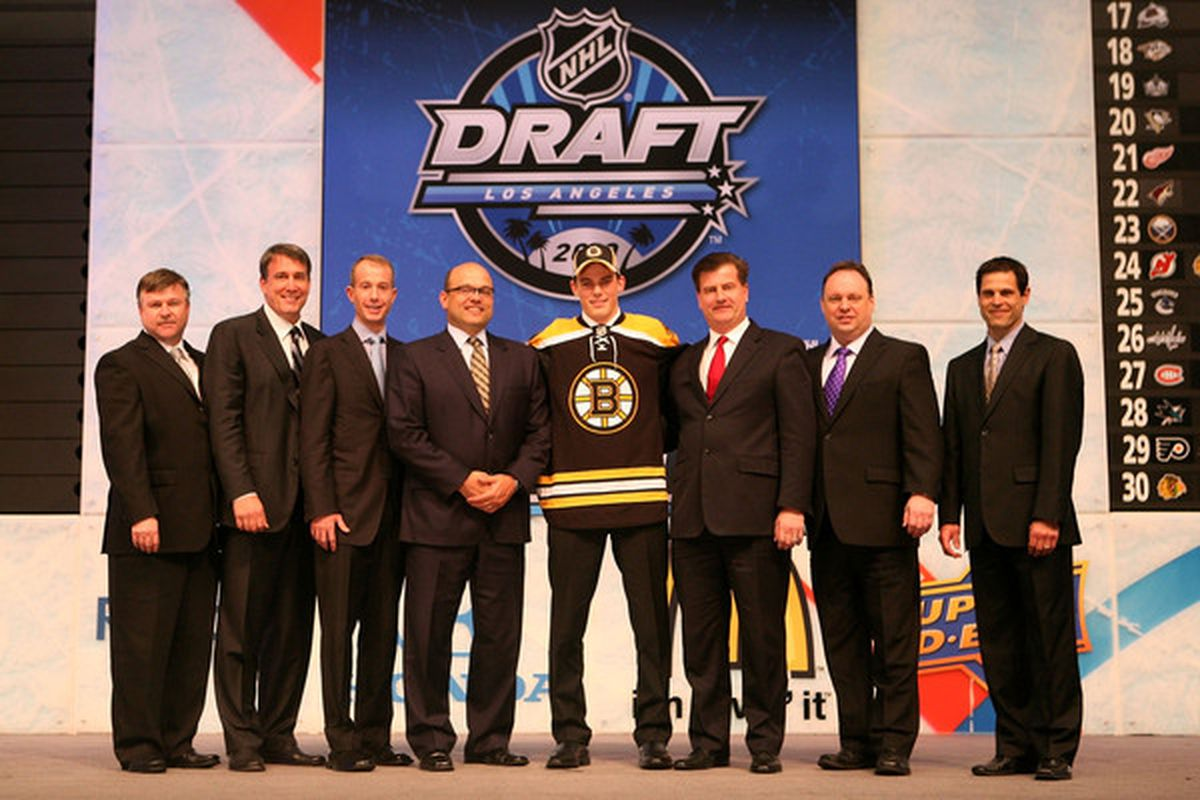 LOS ANGELES, CA - JUNE 25:  Tyler Seguin, drafted second overall by the Boston Bruins, poses with team personnel .during the 2010 NHL Entry Draft at Staples Center on June 25, 2010 in Los Angeles, California.  (Photo by Bruce Bennett/Getty Images)