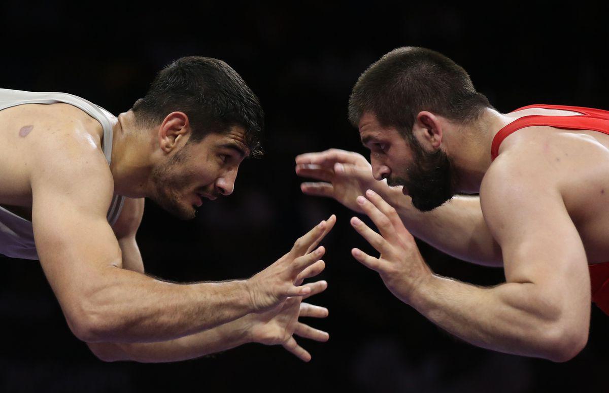 Taha Akgul and Geno Petriashvili face off at the 2018 European Wrestling Championships.