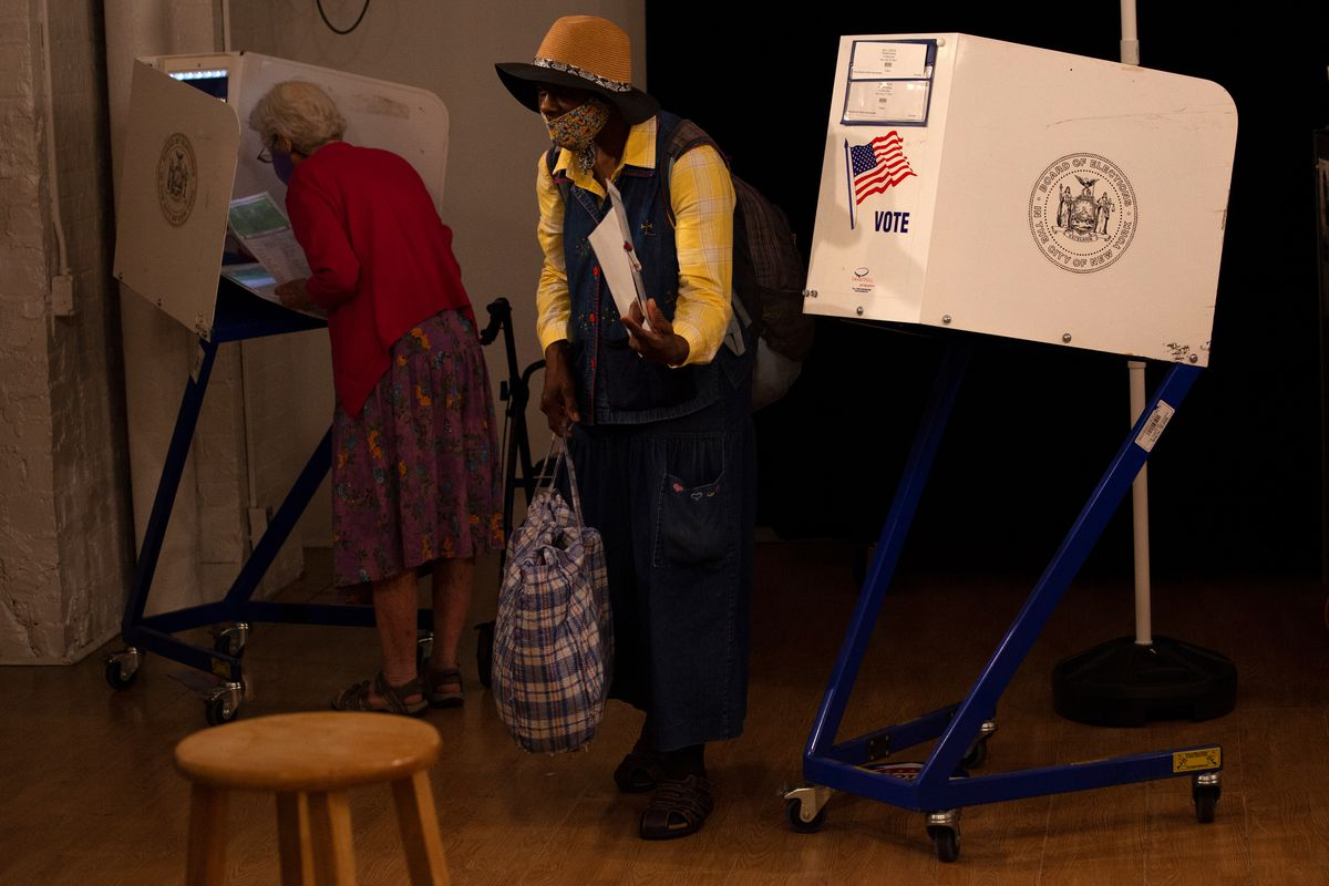 People vote in the West Village on primary day, June 22, 2021.