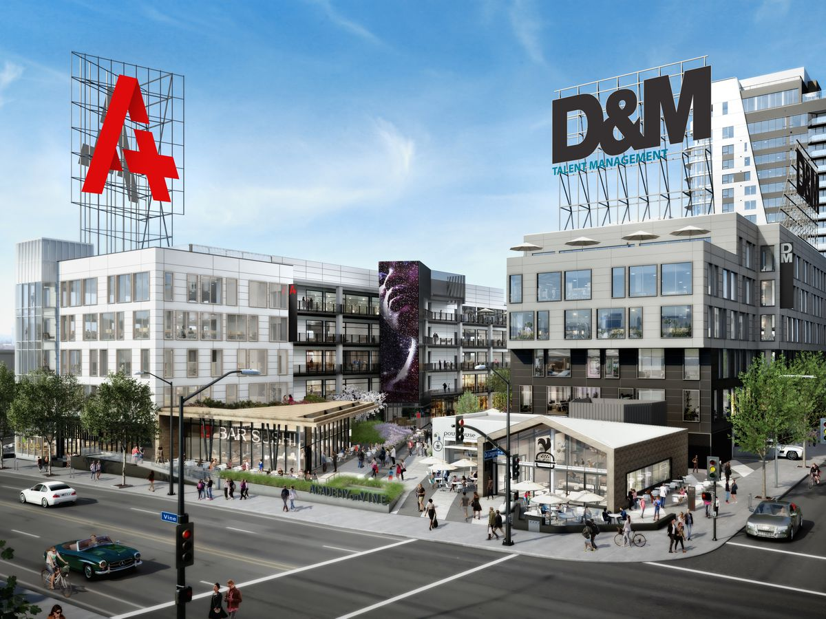 A group of buildings. There are two signs on the buildings. One sign reads D&M and the other sign reads A